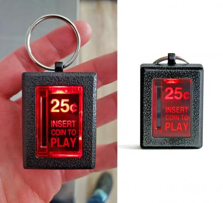 An insert coin arcade key chain that actually lights up